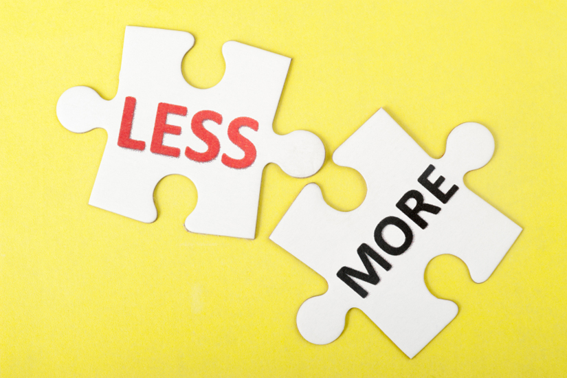 Less and more words printed on two pieces of puzzle
